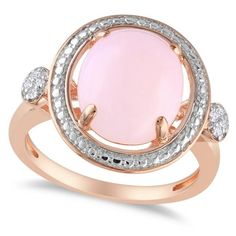 This oh-so-stylish, pink opal fashion ring is a must-have fashion accessory.<p>This right hand ring features a nearly 2 carat round, pink opal solitaire that's prong set in rose gold over sterling silver.<p> With 8 diamond side stone accents (about 0.04 carats) this fashion ring promises countless compliments.
