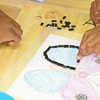 children making community art mosaic
