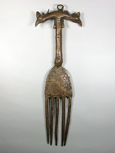 Africa | Brass comb from Benin | Late 20th century