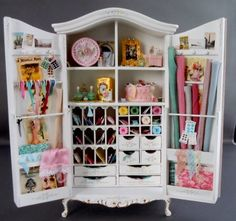 Wonderfully detailed miniature storage cabinet; craft-supply storage - in 1/12 scale.