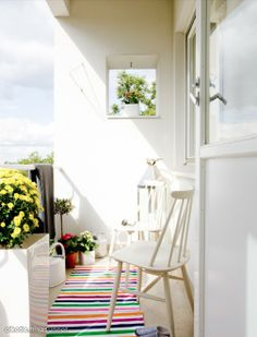 Cute balcony with white chair