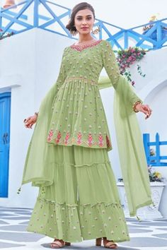 Dazzle everyone around as you walk into a wedding wearing this pistachio green georgette sharara suit which makes it astonishingly charming. This sweetheart neckline and full sleeve suit adorned with thread and faux mirror work. Accompanied by a matching georgette sharara pants in pistachio green color with pistachio green net dupatta. Sharara pants has thread and faux mirror work. #shararasuits #malaysia #Indianwear #weddingwear #andaazfashion Sharara Suit, Pakistani Salwar Kameez, Anarkali, Indian Attire, Indian Wear, Wedding Wear, Wedding Suits, Pantalon Cigarette, Costume