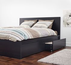 MALM under-bed storage boxes fit beneath the MALM high bed for a clean, built-in look.
