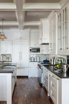 Cottage kitchen features a coffered ceiling with coffers painted grey lined with The Urban Electric Co.