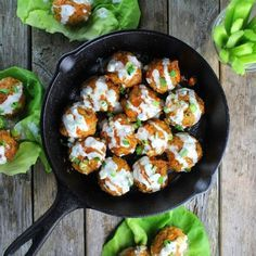 Buffalo Chicken Meatballs! With herbs, veggies, & a little spicy cayenne. Heat is balanced perfectly by the cool, yogurt Blue Cheese Sauce. Healthy & delish!