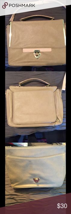 🌷SALE! Tan and rose messenger Last price drop on this item. Super chic way to have a briefcase! It has a pocket on the inside of the flap and a few pockets on the inside as well. It also has an iPad holder on the back that will fit any iPad size other than iPad Pro. It's a taupe gray and soft rose pink. The strap is adjustable too. It's in beautiful condition Olivia + Joy Bags Shoulder Bags