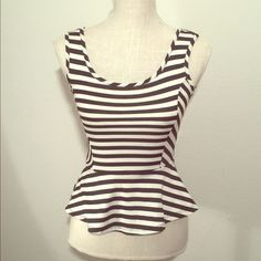 Striped white and black peplum with red bow new From necessary clothing nwot never been worn tank top peplum style striped .. Back has red bow.. Nwot Necessary Clothing Tops Tank Tops