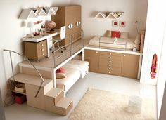 Good design for small kid's room, making study area on an upper level above bed