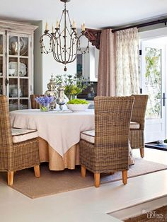 Both purposeful and pretty, two pairs of panels dress the French doors in this dining area. The rod closest to the window supports a transparent floral print -- perfect for letting in light and gaining privacy when pulled closed. The outer drapery, a solid blush color, works to frame the floral fabric, adding even more softness to the feminine space./