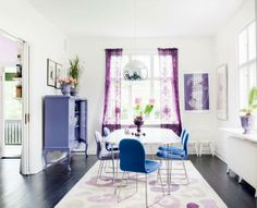 What a great dining room. It's hard to incorporate color like this without making the room look like a kid's room, but I think they did a great job!