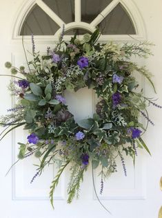 Lavender Wreath-Summer Door Wreath-Provençal Wreath-Summer Wedding Wreath-Herb Wreath-French Country Wreath-All Season Wreath-Foliage Wreath This beautiful summer wreath is a lovely mix of garden herbs and foliages combined with French lavender, Heather, globe thistle and assorted meadow flowers. A plentitude of greenery, including grape ivy, variegated English ivy, juniper, eucalyptus, lambs ears, dusty miller and dandelion create a lush bed that looks freshly gathered and garden-like…