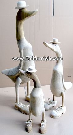 Bamboo ducks with shoes and hat. Wooden ducks made of bamboo root wood. Bamboo root ducks. Visit our web site for more http://www.balifurnish.com/