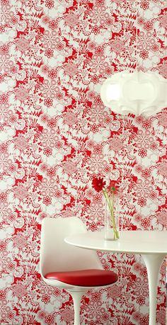Love this red and white wall paper - it's crisp and clean. Great backdrop for cutting edge decor.