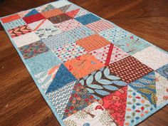 Looking for your next project? You're going to love Fall Charmer Charm Square Table Runner by designer PamelaQuilter. - via @Craftsy