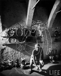 Gjon Mili: Artist Pablo Picasso painting with light at the Madoura Pottery. 1949