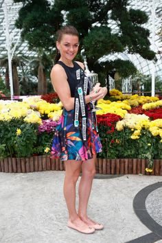 Agnieszka Radwanska of Poland poses with the Billie Jean King Trophy at the Gardens by the Bay on November 2, 2015 in Singapore.