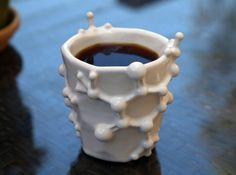 This is the the ceramic Caffeine Molecule Coffee Mug available from Shapeways user joabaldwin. It's a 7-ounce coffee mug with a 3-D caffeine molecule surrounding it. They're available in a handful of colors and cost $99