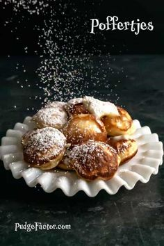 Poffertjes or Dutch Mini Pancakes are small, fluffy yeasted treats made in a special cast iron pan. They are traditionally served with a pat of butter and a good sprinkling of confectioners' sugar.
