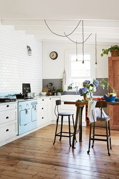 The wooden floor and the light blue accent bring out the rustic beauty