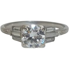 Sleek Art Deco Geometric 1.15ct Diamond Ring in Platinum  $5495. Ctr stone: antique European cut, 0.77 carats, F, VS2. 6 straight baguettes: 3 on each side, open facets like emerald cut, combined 0.38 carats, 1 long 4 1/2mm framed by  pair of 3mm. Hand engraved mounting features linear engraving on all sides, triangular design. Currently size 8 1/2 resizing free. Excellent condition. Certified appraisal $11,980. Measures 6mm across top at widest point. 2mm wide polished band