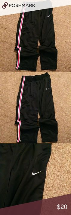 Nike pants Black/ pink Nike pants with draw string zipper at bottom Nike Pants Track Pants & Joggers