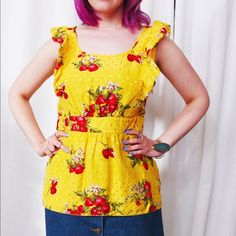 "Juicy Couture Peplum Top Yellow silk ruffled peplum top with strawberry and polka dot print. Size 10. In good gently used condition. Fully lined. Gold buttons at waist. Bust: 20"" Waist: 26.5"" Length: 26"" Juicy Couture Tops Blouses"