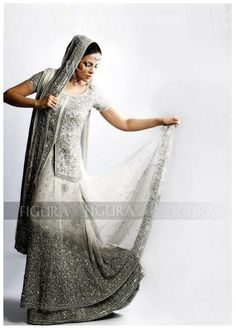 A Beautiful white lehenga with unique silver and grey embroidery