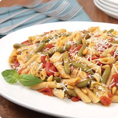 We love this Chicken-Artichoke Penne Pasta recipe by Del Monte® featuring canned green beans and diced tomatoes!