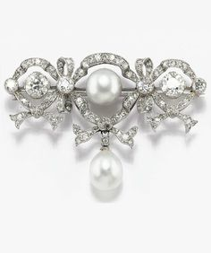 Edwardian PEARL AND DIAMOND BROOCH. Designed as a series of bows, each set with brilliant and rose-cut diamonds, one centring a natural pearl, suspending a natural pearl drop, early 1900s.