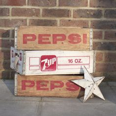 Vintage Pepsi Crate: Lovely original Pepsi Drinks Crate originating from the USA. These still have the Pepsi writing on all sides in red with cut out handles to each end. Ideal as decorative vintage storage or wall mounted for unusual vintage shelving.