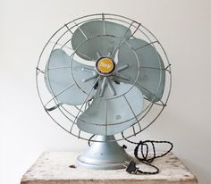 A vintage fan in the palest blue brings a breath of fresh air into any room. #etsyvintage