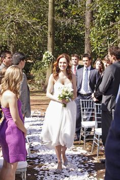 Pin for Later: Flashback: All the One Tree Hill Weddings Lucas and Peyton's Wedding Peyton, sporting brunette locks and a baby bump, walks herself down the aisle.