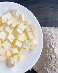 Diced butter on a plate before being poured into a bowl of flour to make Easy All Butter Pie Crust from themerchantbaker.com