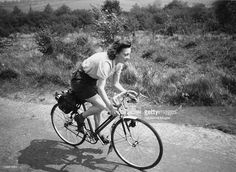 A young woman enjoys a day out on her bicycle in Surrey, 1948. Original…