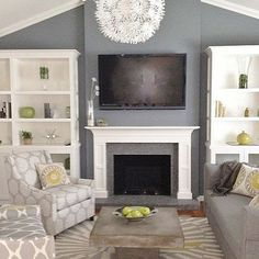 Considering white fireplace but it goes up the height of the ceiling (brick, painted white) with a dark gray accent wall. hmmm?