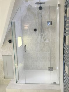 Frameless Shower Enclosure Shaped To Sloping Roof With Bonded Return Panel,  In Ultra Clear Low
