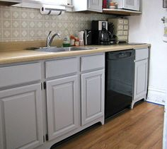 s 15 easiest ways to totally transform your kitchen cabinets, kitchen cabinets, kitchen design, Make them look built in with faux legs