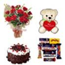 12 Red Roses Bunch ,Teddy Assorted Cadburys & 1Lb Cake.  Available at : www.flowersgiftshyderabad.com/Anniversary-Gifts-to-Hyderabad.php