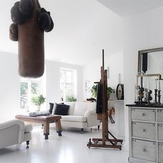 Pic from todays PHOTOSHOOT in the danish countryside | Me and @fotografthereseromell visited the lovely home of @henrikhemmingsen | Lots of cool vintage stuff like a boxningsack hanging from the roof, a gymbench as a coffeatable and an easel for the flat screen tv....| #photoshoot #interior #inspiration #whiteinteriors #vintage #livingroom