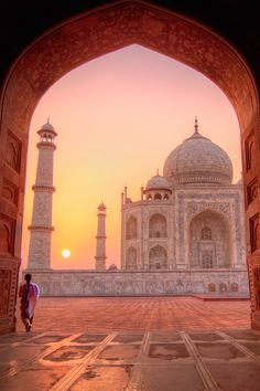 Taj Mahal at sunrise - Agra, India  I was lucky enough to witness this.  Something I will never, ever forget.. Just breathtaking...