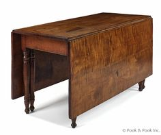 """Pennsylvania Sheraton tiger maple dining table, ca. 1820, with a dropleaf top overhanging a base with six turned legs, 28"""" h., 67"""" w., 50 1/4"""" l."""