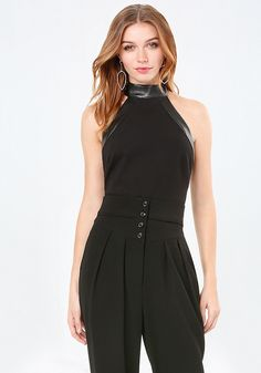 Be-seen top in a halter cut finished with edgy faux leather. Sexy back keyhole. Back neck button-loop closures. Back hook-and-eye and exposed zip closure. Fully lined.