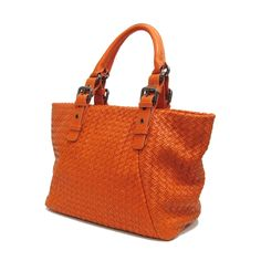 "First class bags like this bold orange number tell others that you never settle for ""passable"" style."