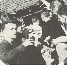 An OSC student is captured by UO students during homecoming 1937 and eventually thrown into the MIllrace.  From the 1938 Oregana (University of Oregon yearbook).  www.CampusAttic.com