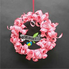 curled paper ribbon wreath on embroidery hoop