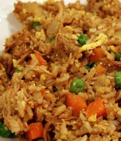 Quick Chicken Fried Rice. Cooked rice and chicken; onion, peas and carrots; eggs; sesame oil; soy sauce