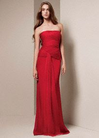 Long and luxurious bridesmaid dress with beautifully draped bodice and soft flowing sash.   Strapless column gown features asymmetrical draped bobbin net bodice and flowing sash.  Available in seleect stores and online.  Sizes 16-26 are available in stores only.  Fully lined. Side zip. Dry clean only.  Imported.