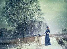 Winter painting of girl with borzoi dogs.