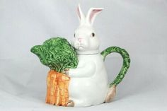 Fitz and Floyd Omnibus Bunny Rabbit Carrot White Orange Green Teapot 32 Oz Measurement: 9.5 in h x 9.5 in w x 4.5 in l Condition: Pre-owned, no chips, no cracks. Unique Gifts For Men, Alexander Dolls, Travel Souvenirs, Chocolate Pots, New Toys, Bunny Rabbit, Old And New, The Ordinary, Carrot