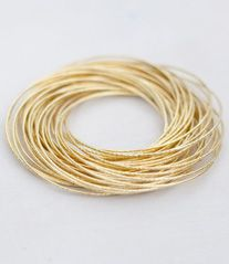 I love these simple skinny bangles...and I'm hoping to win them! Pin it to win it...with www.noondaycollection.com